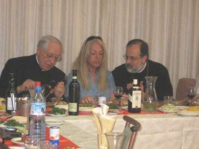 Vassula with Archbishop Georges and Fr. Habiby to her right, at lunch