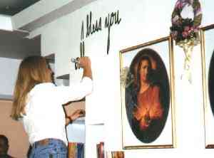 Vassula is photographed while writing Jesus' message onto the wall