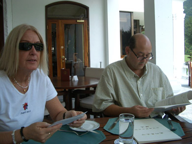 Mario and Vassula studying the CDF booklets in Chinese and discussing TLIG prayer groups
