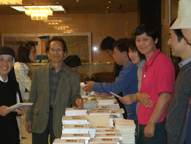Mr. Hayashi, the publisher of TLIG books in Japan, among TLIG helpers and readers