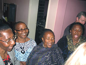 Ladies from Soweto arriving late, happy to greet Vassula at the back entrance