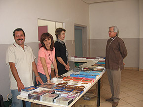 Volunteers providing TLIG materials