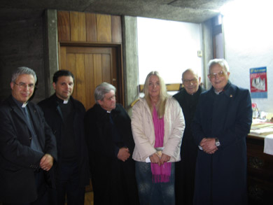 Vassula with priests after the talk