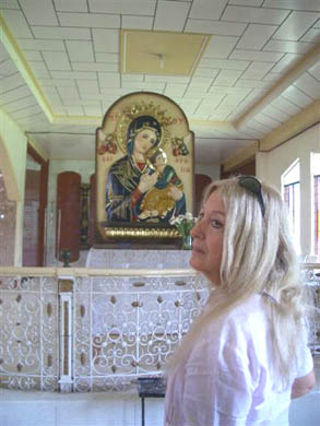A representation of the Orthodox image of Our Mother of Perpetual Help, beside the altar in the Church of the Holy Angels, Tuao