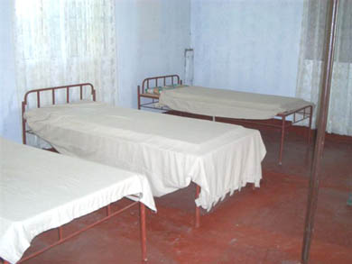 Hospital beds for the sick in Beth Myriam, Tuao