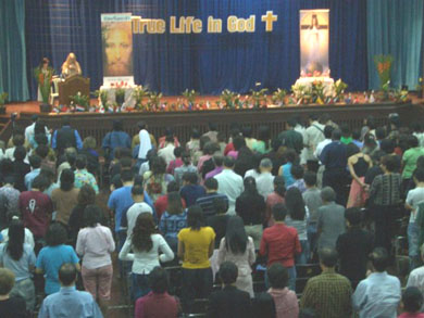 People standing, invoking the Holy Spirit for healing and deliverance